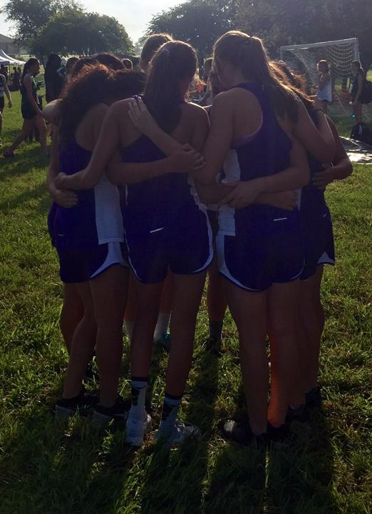 The XC girls get ready to run before a meet. srubel photo