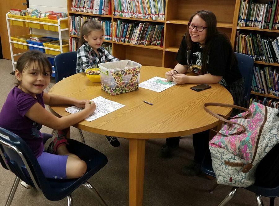 Senior mentors visit elementary students