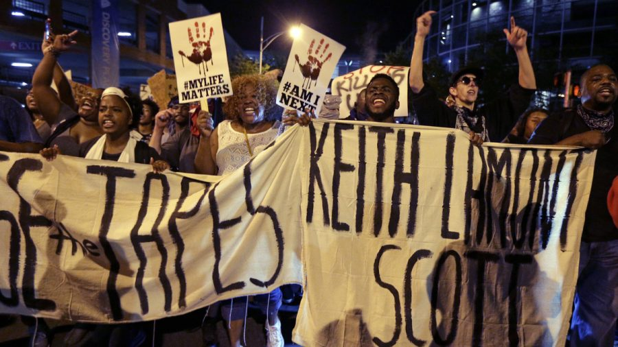 People march in Charlotte, N.C., on Sept. 23 to protest the fatal police shooting of Keith Lamont Scott. The Mecklenburg County district attorney said Wednesday he was
