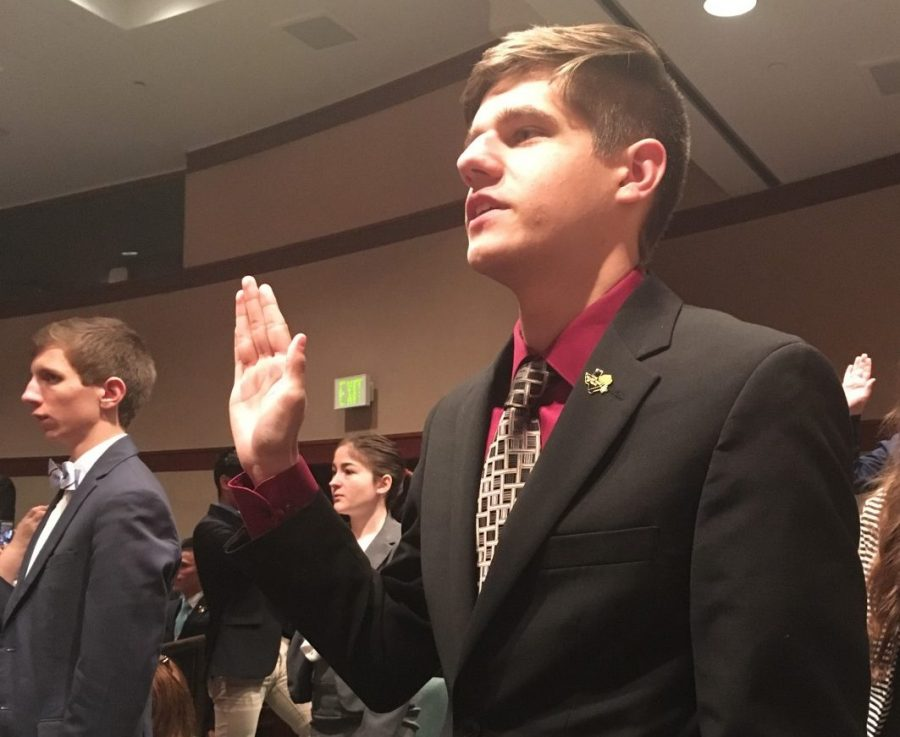 Senior Evan Grisham takes the Oath of Office before competing in state Congress finals in the Texas Capitol last week. Evan was one of 18 3A debaters who made it to finals.