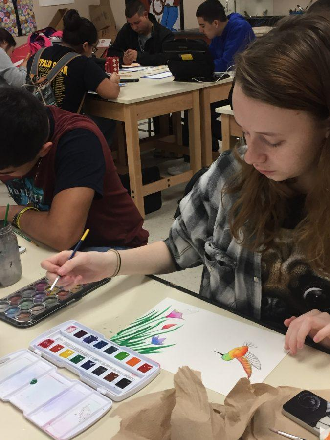 Art students learn to use watercolors