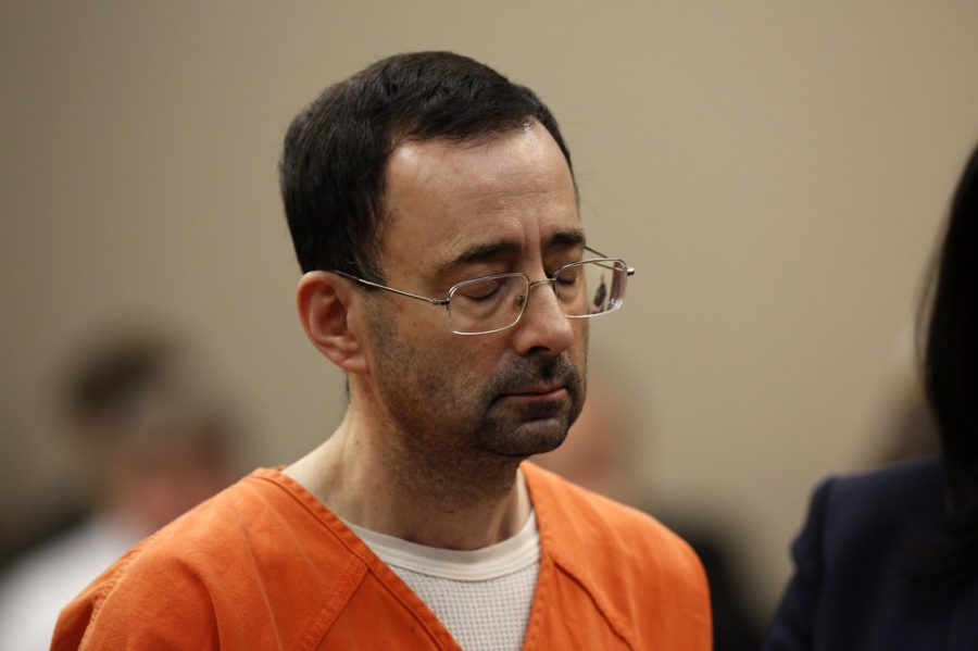 Former Michigan State University and USA Gymnastics doctor Larry Nassar appears at Ingham County Circuit Court on November 22, 2017 in Lansing, Michigan.   Former USA Gymnastics team doctor Lawrence (Larry) Nassar, accused of molesting dozens of female athletes over several decades, on Wednesday pleaded guilty to multiple counts of criminal sexual conduct. Nassar -- who was involved with USA Gymnastics for nearly three decades and worked with the country's gymnasts at four separate Olympic Games -- could face at least 25 years in prison on the charges brought in Michigan.  / AFP PHOTO / JEFF KOWALSKY        (Photo credit should read JEFF KOWALSKY/AFP/Getty Images)