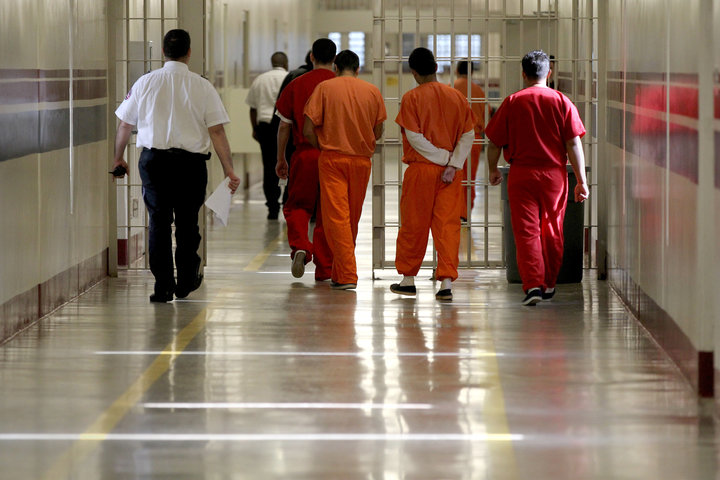 LUMPKIN, GA - MAY 4: Detainees at the Stewart Detention Center in Lumpkin, Ga. are escorted through a corridor. (Photo by Jonathan Wiggs/The Boston Globe via Getty Images)