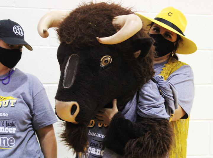 Gold Out pep rally sees students fighting for spirit sticks