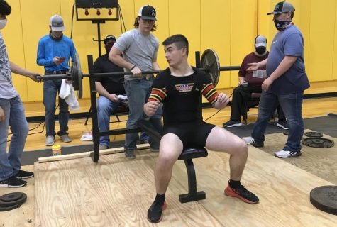 Sophomore Xander Cheek gets ready to lift at a recent meet in Fairfield. The boys lost two meets due to weather.
