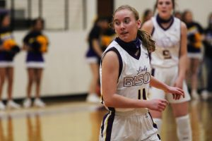 Freshman Elizabeth Daniel makes her way down the court during a basketball game. Daniel is on multiple varsity teams this year.