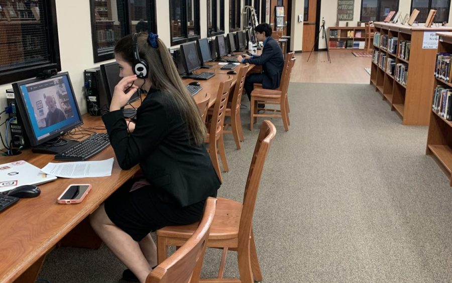 Debater competitors Nicolette Arabie and Omar Almeida competed through the early hours of the winter storm but then had to postpone finals when UIL decided to wait because so many students were losing power and Internet.