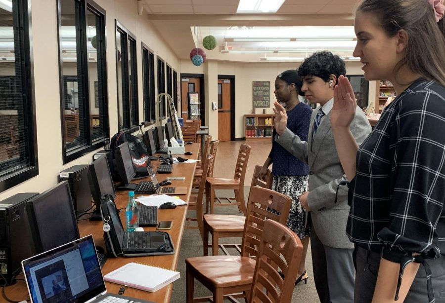 Nicollette Arabie, Omar Almeida and Jalea Brown take the COngressional Oath before competing in the debate for NSDA. Arabie and senior Kyle Hurst made finals.