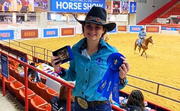 Senior Josie Henson shows off her winnings from the Houston Livestock Show and Rodeo. Josie will ride for the Sam Houston State University team next year.