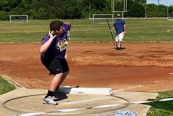 Senior Asa Henson competes in shot put at the regional track meet.
