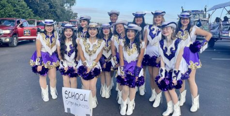 The Bison Belles line up for the start of the Buffalo Stampede parade. The event was back after a year off due to COVID.