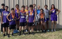 The Bison cross country runners show off the medals they earned at the Teague meet.