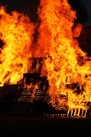 The bonfire burned brightly after the seniors lit the diesel poured around the outside row of pallets.