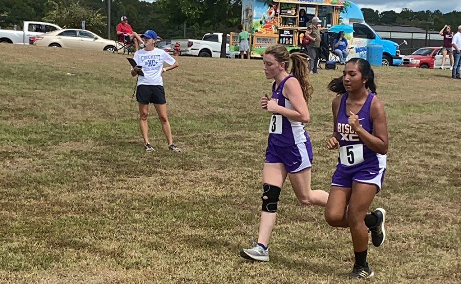 Lady Bison runners Emma Cocking and Kaylee Rodriguez near the finish line during the district cross country meet. Cocking battled a hurt knee most of the season.