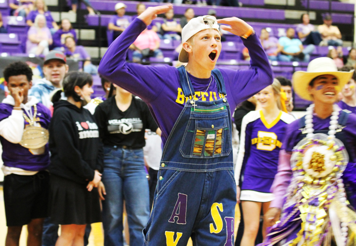 Senior Riley Ayres works to pump up the youngest members of the crowd during voting for a spirit stick point at the homecoming pep rally.