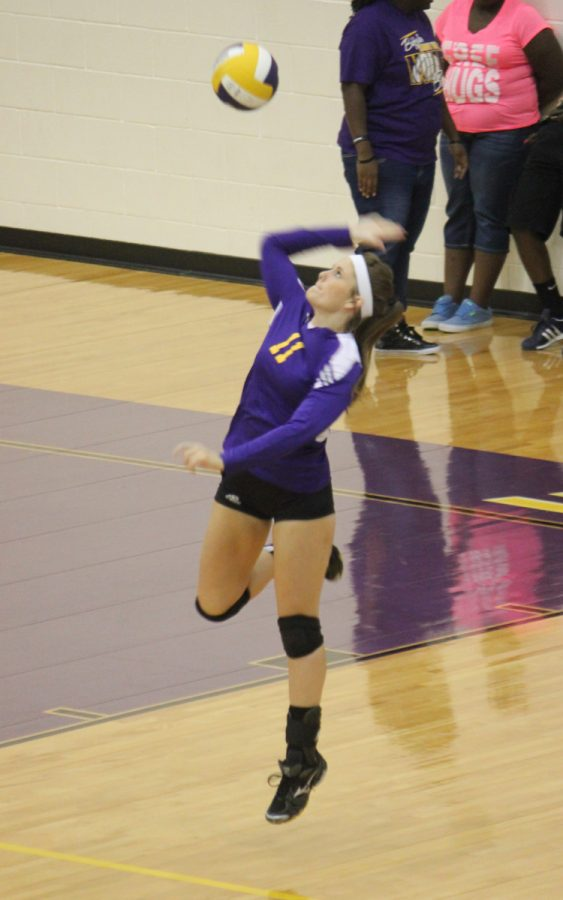 Senior Taylor Rutledge gets off the floor to sned the ball over the net for a point in the Lady Bisons preseason game against Oakwood. The Ladies won in three sets.