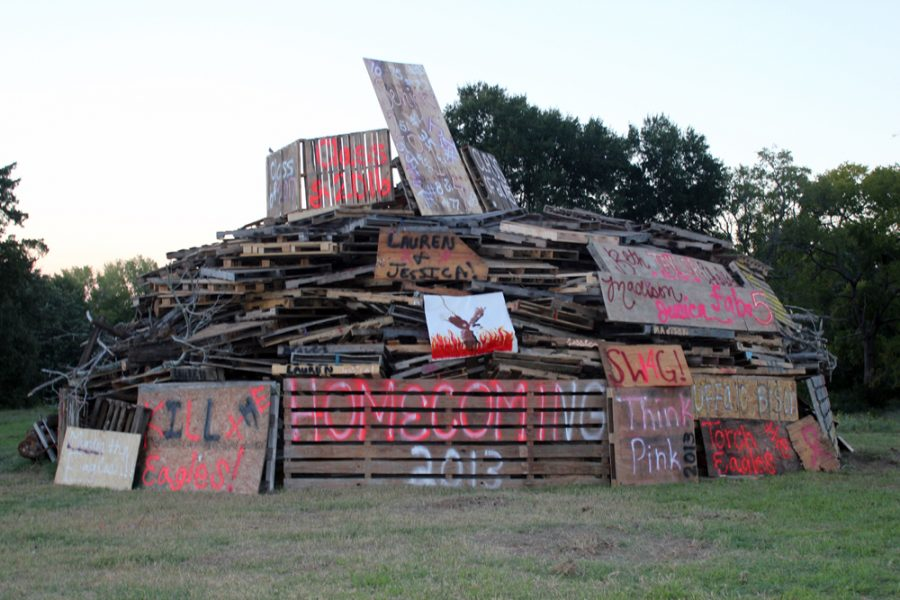 Students+and+faculty+worked+together+to+build+the+first+bonfire+at+BHS+for+the+past+two+decades.+