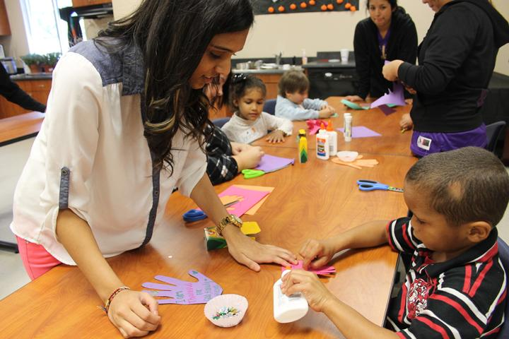 Junior+Ekta+Patel+helps+one+of+the+kindergarteners+with+her+project.+The+FCS+students+spent+most+of+the+day+working+with+the+younger+students.