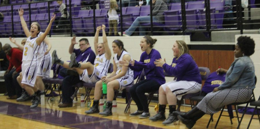 The+bench+explodes+as+freshman+Jordan+Jenkins+hits+a+three+at+the+buzzer+to+put+the+Lady+Bison+on+top+of+the+Riesel+team+and+the+district.+The+girls+will+take+on+Anderson-Shiro+next+week+in+the+first+round+of+the+playoffs.