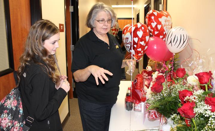 Secretary+Beverly+Cummings+helps+sophomore+Ally+Gaskins+find+her+Valentine.