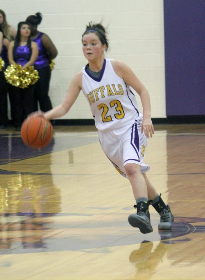 Junior+Taryn+Morman+drives+to+the+basket+during+the+game+against+Blooming+Grove+earlier+this+week.+The+Lady+Bison+hope+to+come+out+on+top+of+district+overall+and+head+to+the+playoffs.