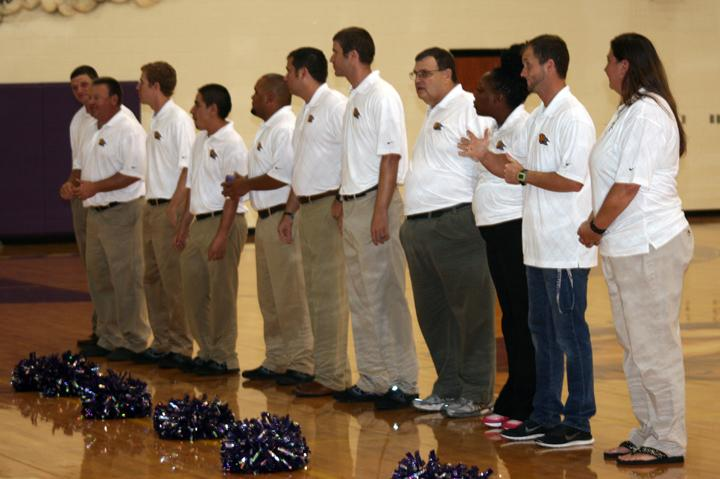The+coaching+staff+stands+to+be+introduced+during+Meet+the+Bison.+