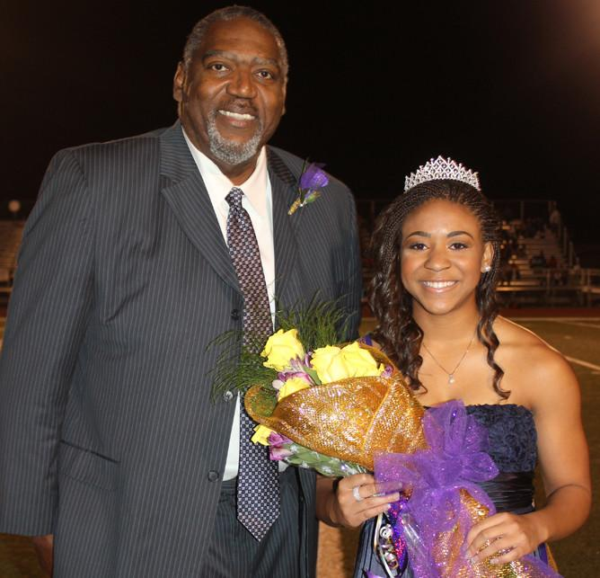 Homecoming Queen Erykah Anderson poses with her escort, father Mike Anderson, after being crowned.