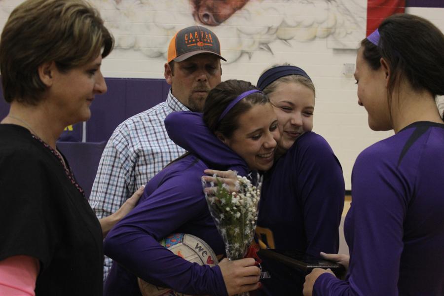 Senior+Marissa+Jones+gets+a+big+hug+from+junior+Jacie+Jones+on+senior+night.