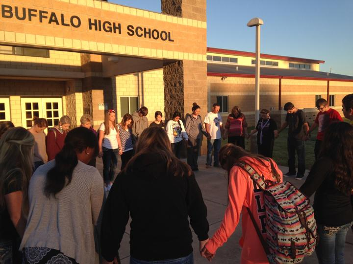 Students+and+teachers+gather+in+front+of+the+building+for+See+You+at+the+Pole+last+week.