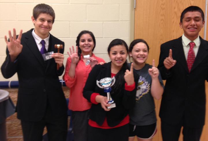 Debaters+Evan+Grisham%2C+Kendall+Morales%2C+Nadia+Garcia%2C+Lilah+Molina+and+Jordy+Maltos+pose+with+their+round+wins+and+hardware+after+a+speech+meet+in+Leon.+The+speech+team+will+compete+at+two+more+meets+in+December.