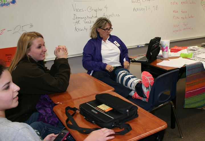 Spanish+teacher+Cindy+Eppes+teaches+with+her+leg+up+after+fracturing+her+leg+last+week.