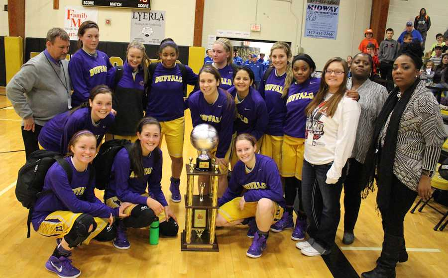 The+varsity+Lady+Bison+pose+with+their+second-place+trophy+at+the+end+of+the+tournament.