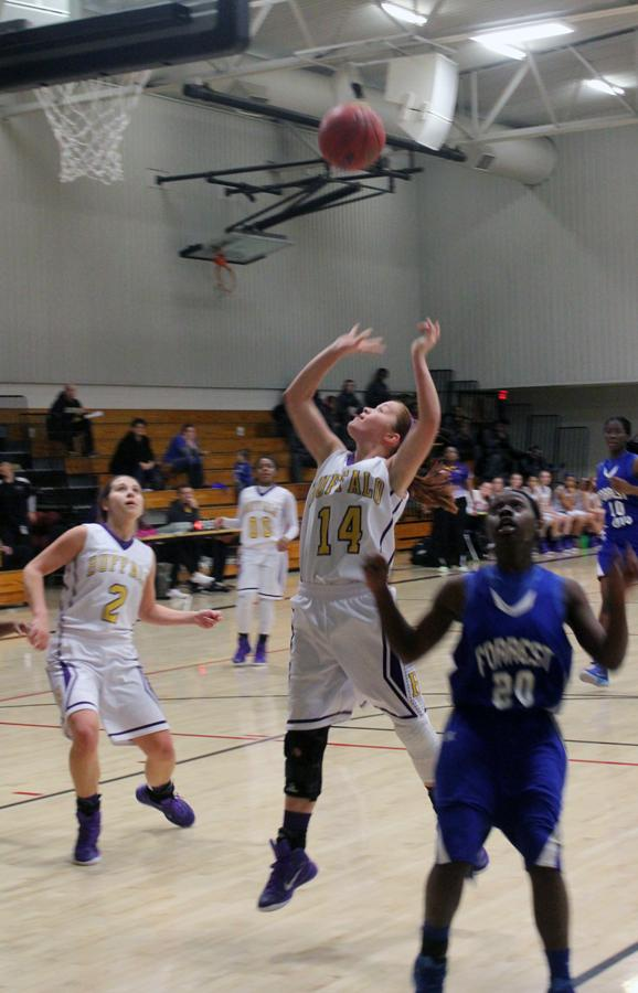 Junior Taylor Shelton goes up for two points.