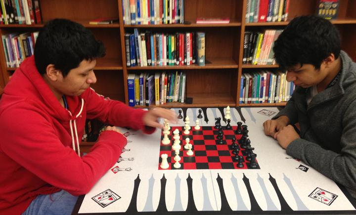 Seniors+Rudy+and+Randy+Salazar+play+chess+in+the+library.+The+twins+swapped+spots+for+their+morning+classes+last+week.