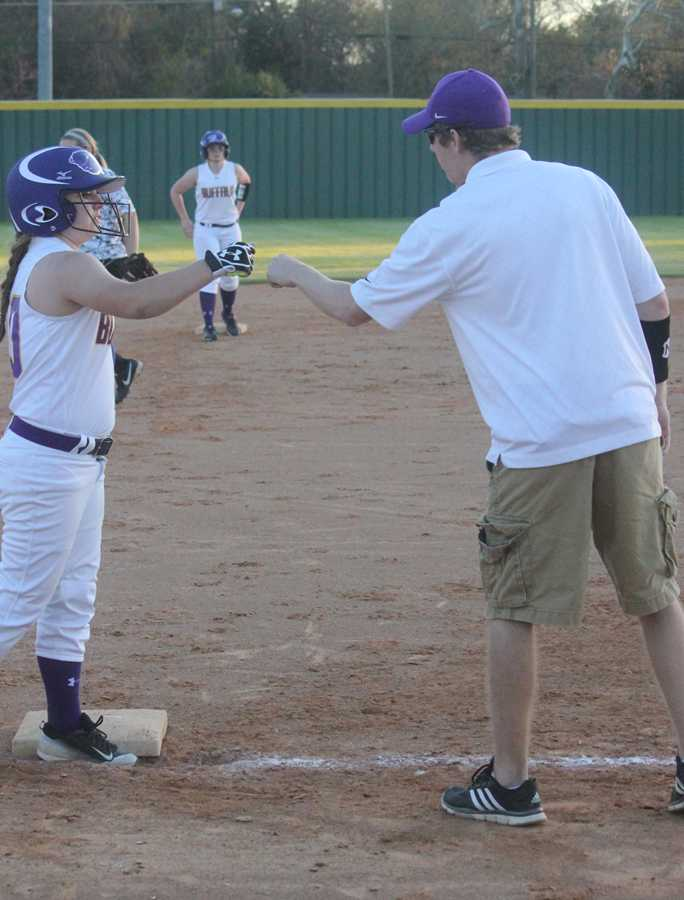Ima Champion gets some praise from Coach Grubbs after making it to base.