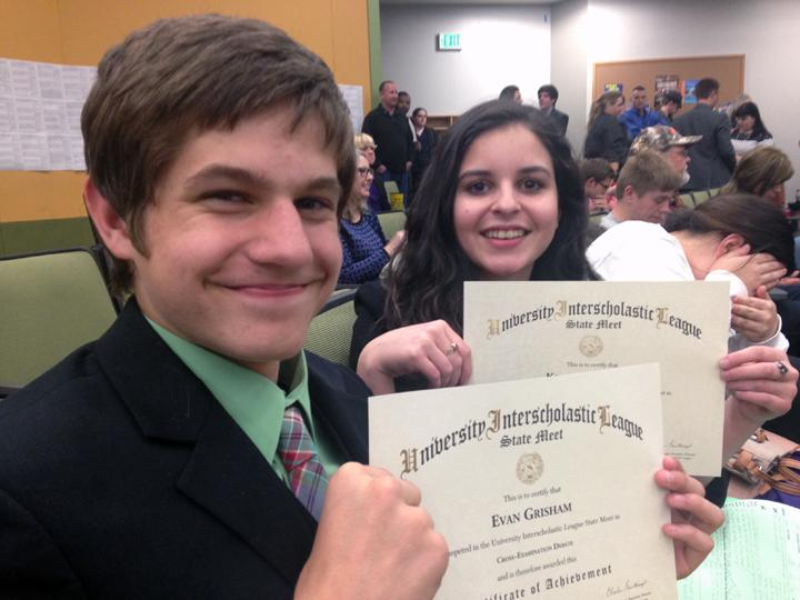CX+debaters+Evan+Grisham+and+Kendall+Morales+show+off+their+state+certificates+after+finding+out+that+they+would+be+advancing+to+the+finals+round+of+the+state+meet.
