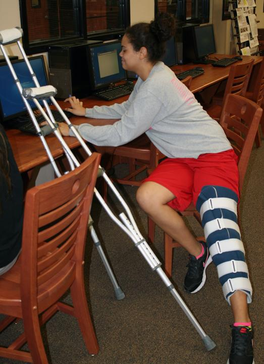 Freshman Joselyn Taylor found herself on crutches after an injury during Belle practice.