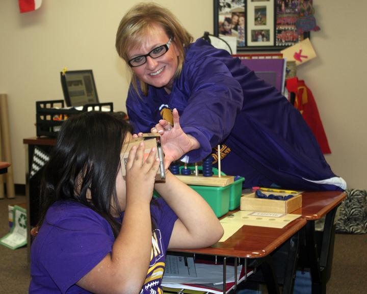 Teacher+Katie+Villarreal+helps+freshman+Lizette+Vazquez+with+the+new+viewer+during+class.
