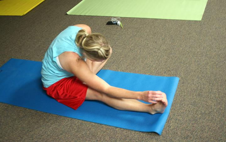 Teacher+Jill+Henson+stretches+during+yoga+class.+The+teachers+get+together+every+Monday+and+Wednesday+for+the+class%2C+which+is+taught+by+teacher+Cindy+Eppes.