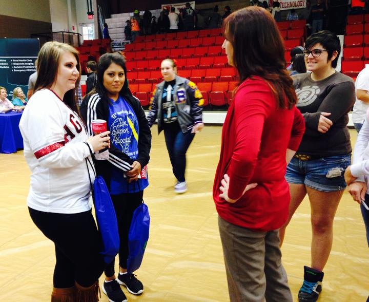 Seniors Makayla Troyer and Brittnie Garcia discuss career options with a vendor at the Navarro College Career Fair.