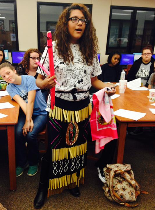 Senior Miryam Zapata shares some of the items and dress used in her culture's dances.