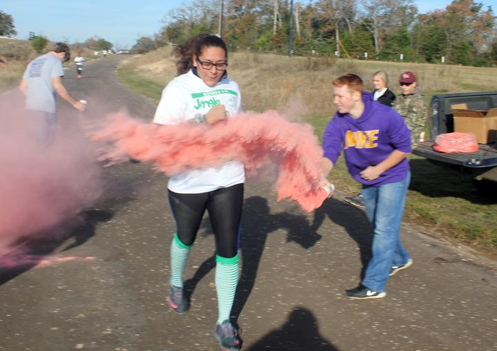 Senior+Miryam+Zapata+takes+a+hit+of+color+from+4-H+member+Matt+Gilliam+during+the+color+run.