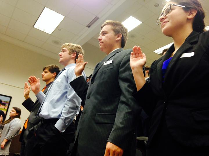 Congressional+debate+students+Kendall+Morales%2C+Noah+Rubel%2C+Logan+Freeman+and+Evan+Grisham+are+sworn+in+before+district+sessions.+This+was+the+first+year+for+BHS+students+to+compete+in+this+event.
