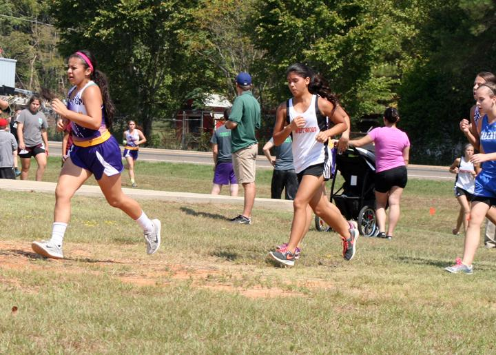Sophomore+Nadia+Garcia+leads+a+pack+of+runners+during+a+cross+country+meet.