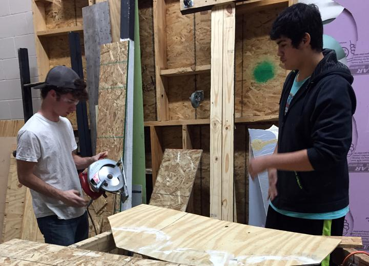 Tech members David McAlpine and Israel Rendon break out the power tools while working on the OAP set.