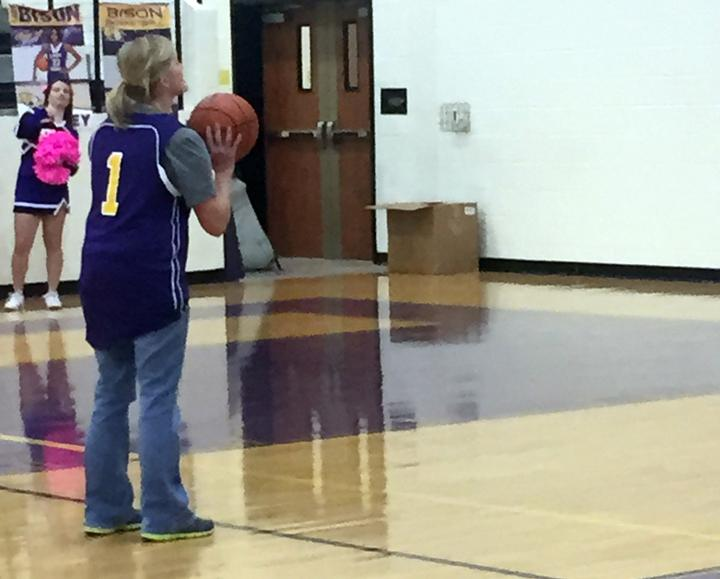 Theatre teacher Jill Henson gets ready to shoot her free throw. Henson missed the shot, but rebounded the ball and made the basket.