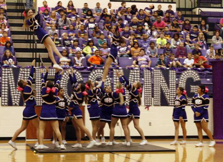 The+cheerleaders+perform+at+a+football+pep+rally+earlier+in+the+year.+The+group+will+be+competing+this+week+in+UIL+competition%2C+which+is+a+new+addition+for+the+UIL.