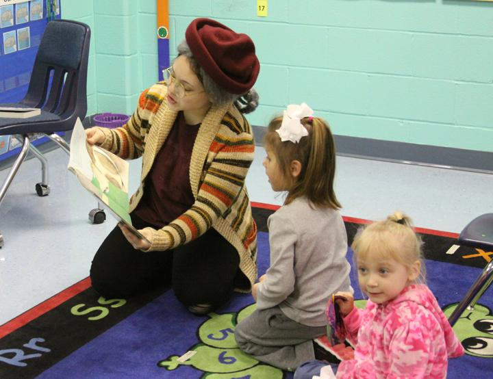 Sophomore Lilah Molina reads a story while dressed as The Little Old Lady Who Swallowed the Fly.