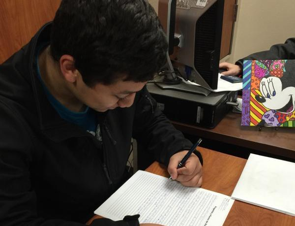 Junior Jeffrey Pineda works on an assignment during class.