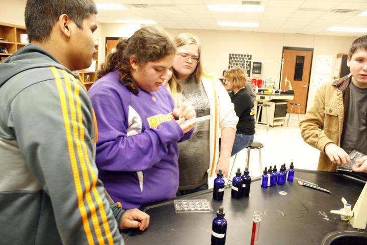 Students works on typing blood during forensics class.